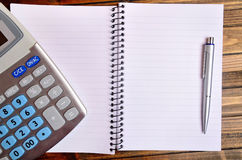 Notebook with calculator and pen Stock Photography