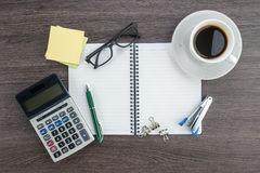 Notebook, Calculator, Stapler and cup of coffee Royalty Free Stock Images