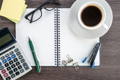 Notebook, Calculator, Stapler and cup of coffee Royalty Free Stock Photos