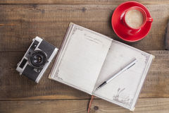Notebook Camera and Coffee Stock Images