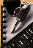 Car key and computer keyboard Stock Photos