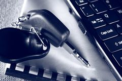 Notebook, car key and keyboard Stock Images