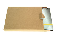 Notebook in cardboard box isolated on a white back Stock Photography