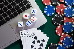 Notebook, cards, dice and chips on green baize. Online casino always there. Copy past Royalty Free Stock Images