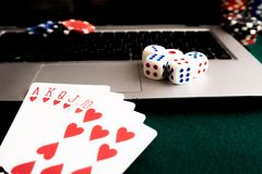 Notebook, cards, dice and chips on green baize. Online casino always there. Copy past Royalty Free Stock Photography