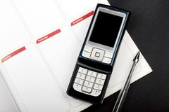 The notebook and cellular phone Royalty Free Stock Image