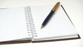 NOTEBOOK IN CHECK II. PICTURE WITH NOTEBOOK  AND GOLDEN PEN Stock Photos