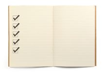 Notebook with checklist. Open lined notebook with checklist boxes against white background, minimal natural shadow in front Royalty Free Stock Photography