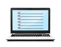Notebook with checklist Royalty Free Stock Photos