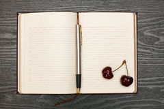 Notebook and cherry Stock Photo