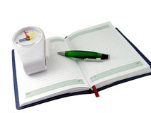 Notebook and clock. In white background Royalty Free Stock Photo