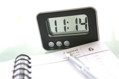 Notebook and clock stock image