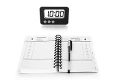 Notebook and clock Royalty Free Stock Image