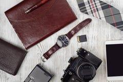 Notebook clock mobile phone tie flash drive photo camera wallet Stock Photos
