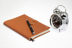 Notebook with clock Stock Images