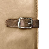 Notebook closeup with buckle in the form of a leather strap Royalty Free Stock Photo