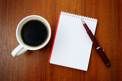 Notebook and coffee Royalty Free Stock Images