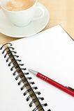 Notebook, Coffee and Ballpoint Royalty Free Stock Photography