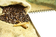 Notebook and coffee beans Stock Images