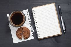 Notebook and coffee with cookie Stock Photos