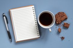 Notebook and coffee with cookie Stock Image