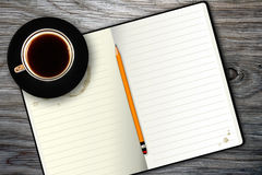 Notebook and coffee cup Stock Photo