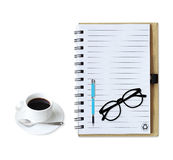 Notebook with  coffee cup with pen and glasses on white Royalty Free Stock Images