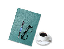 Notebook with  coffee cup with pen and glasses on white Royalty Free Stock Photography