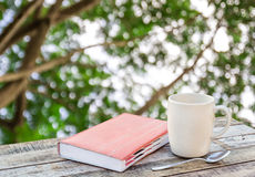 Notebook and coffee cup on wood table Stock Photography