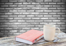 Notebook and coffee cup on wood table Royalty Free Stock Photo
