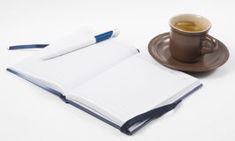 Notebook and coffee Stock Images