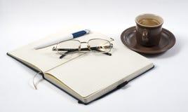 Notebook coffee and pen Stock Photos