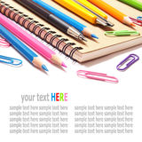 Notebook and color pencils stationery isolated on white Royalty Free Stock Photography