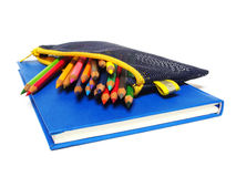 Notebook and color pencils stationery isolated on white Royalty Free Stock Photos