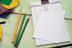 Notebook and colored fabric Stock Image