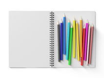 Notebook with colored pencils on White background Stock Photos