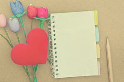 Notebook with colorful artificial tulips heart shape a Royalty Free Stock Images