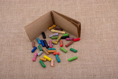 Notebook beside colorful crayons Stock Photo