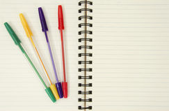 Notebook and colorful pens Royalty Free Stock Photo