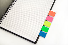 Notebook with colour sticks. On the white background Stock Image