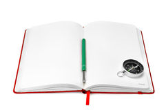 Notebook and compass Stock Images