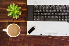 Notebook computer with coffee cup, computer and flower. View fro stock images