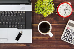 Notebook computer on the desk.Calculators,USB flash drive stick,coffee cup.  stock photos