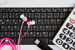 Notebook computer on the desk.Calculators,USB flash drive stick,Earphone stock photo