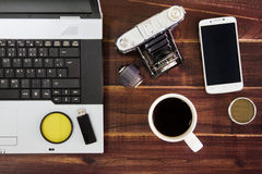 Notebook computer on the desk.USB flash drive stick,coffee cup,camera,smartphone stock photo