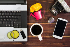 Notebook computer on the desk.USB flash drive stick,coffee cup,c Stock Photo