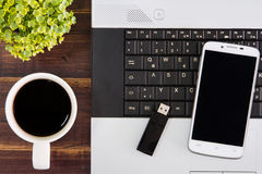 Notebook computer on the desk.USB flash drive stick,coffee cup,s Stock Photo