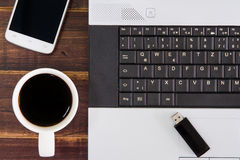 Notebook computer on the desk.USB flash drive stick,coffee cup,s Royalty Free Stock Image