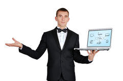 Notebook with computer network. Businessman in tuxedo holding notebook with computer network Stock Photography