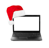 Notebook computer and Santa Claus red christmas hat Stock Photo